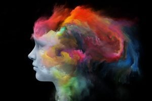 woman's head swirling with colorful clouds
