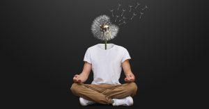 young man with a white dandelion as a head sitting in a meditation position with legs crossed