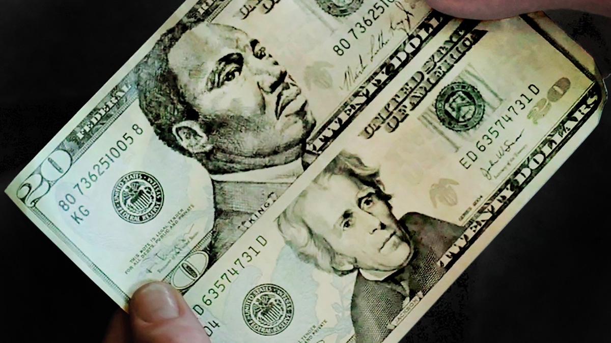 hands holding a Martin Luther King 20 dollar bill and a regular 20 dollar bill (photo via Concrete Jungle blog)