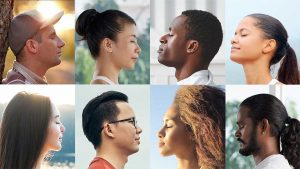 the faces of eight diverse people meditating in a grid