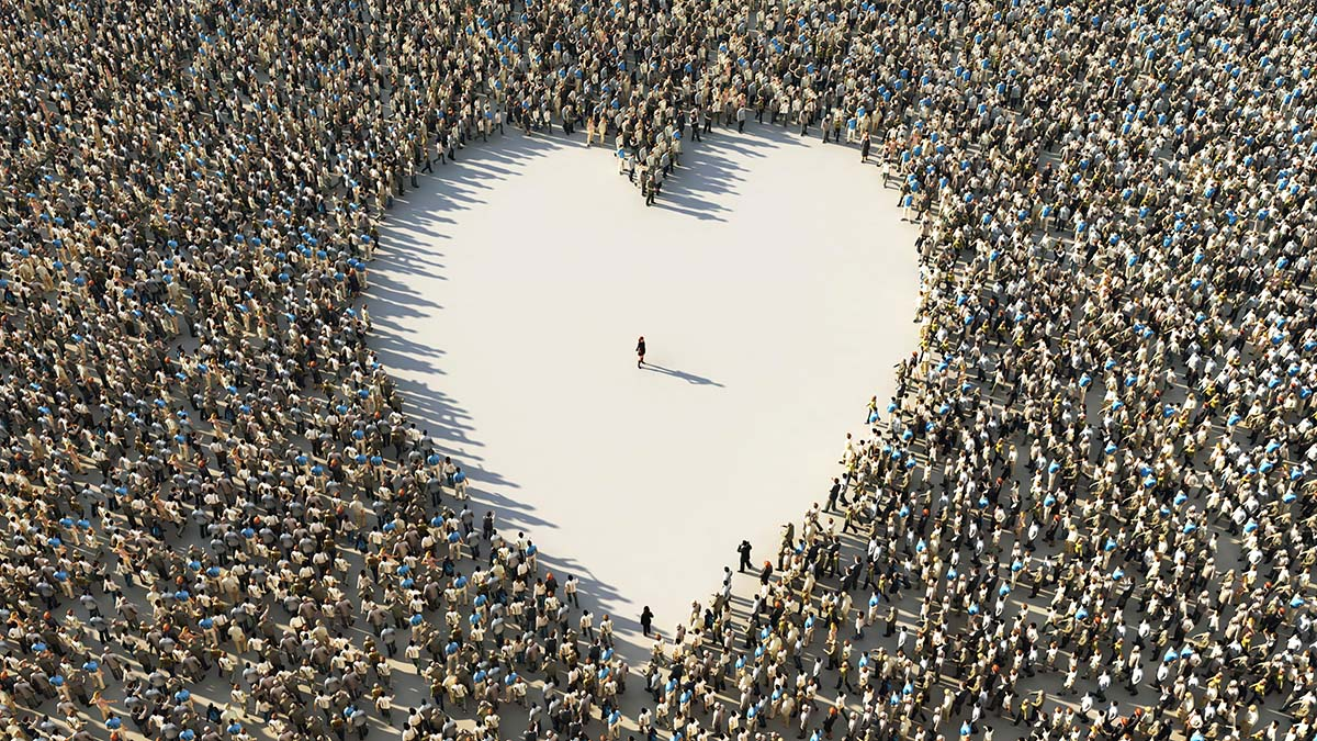 woman in the center of a heart-shaped crowd from above