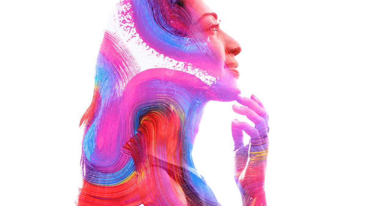 joyful young Black woman with head made of paint swirls