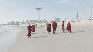Tibetan monks on the beach at Coney Island Brooklyn by Eric Gross