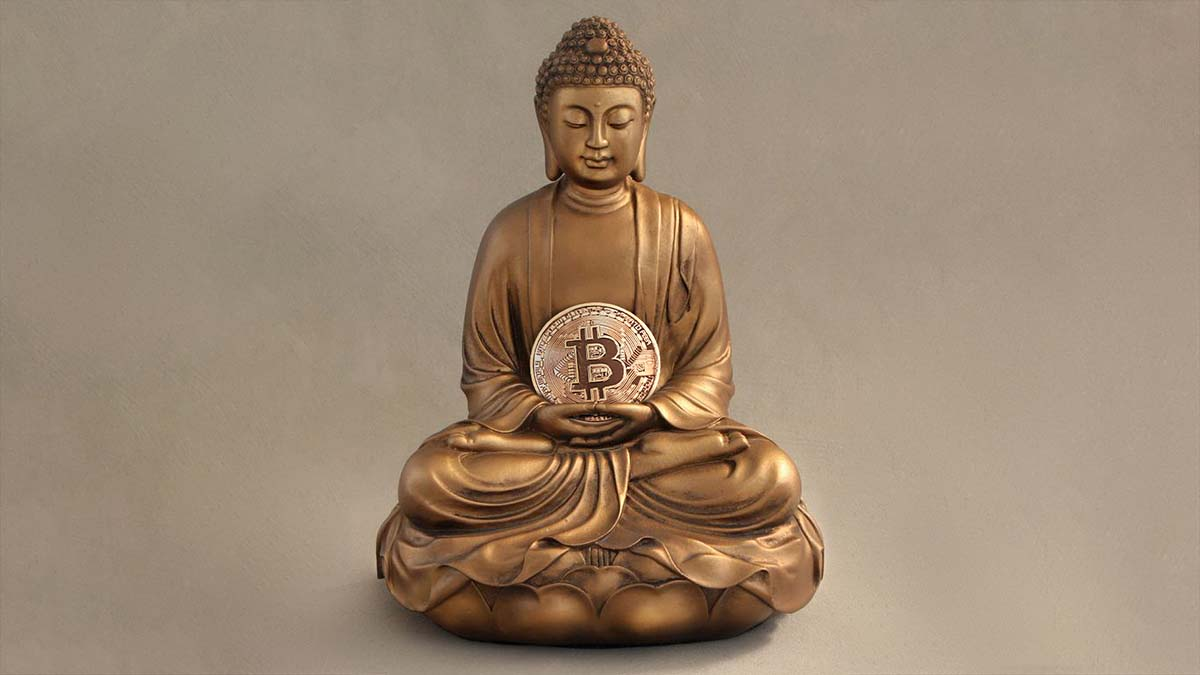 Bronze Buddha statue holding bitcoin