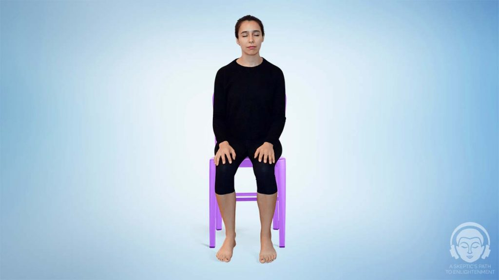 meditating in a chair